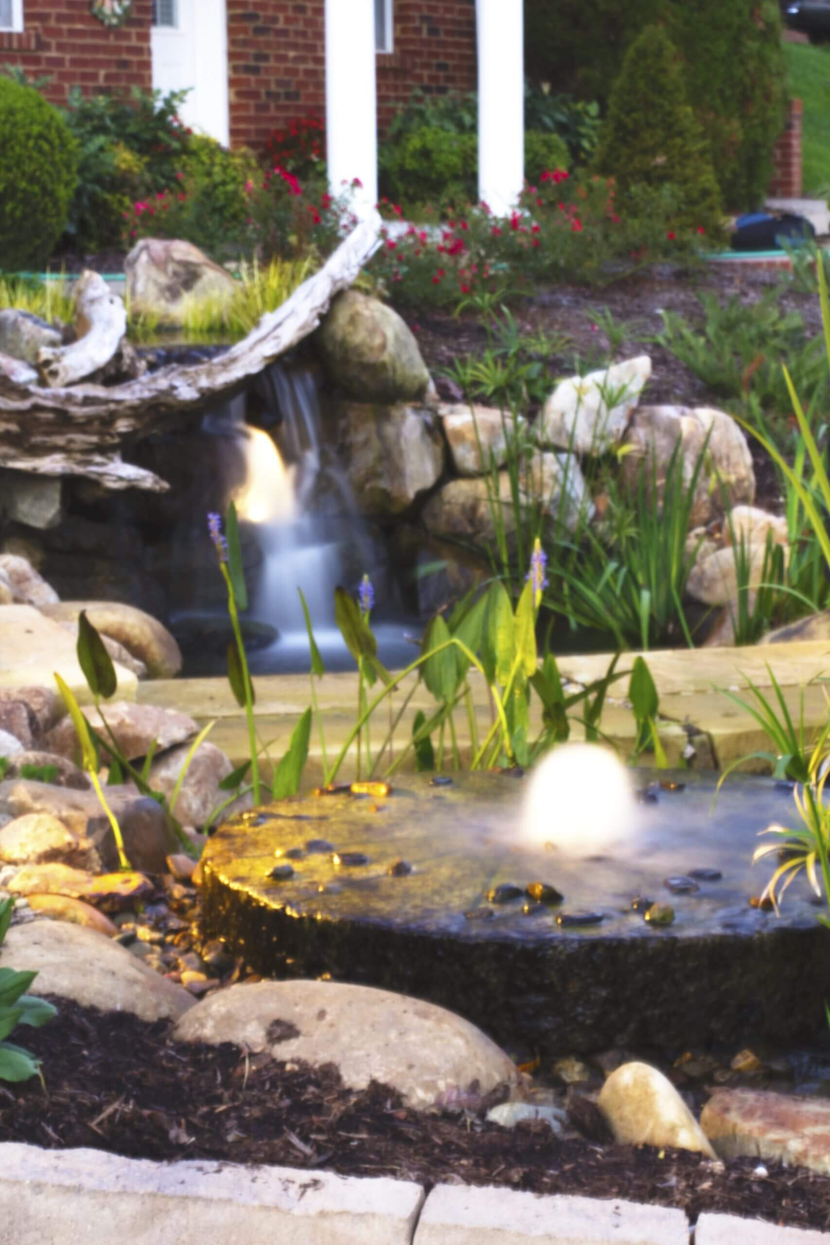 Pondless waterfall natural stone steps for Custom landscape design