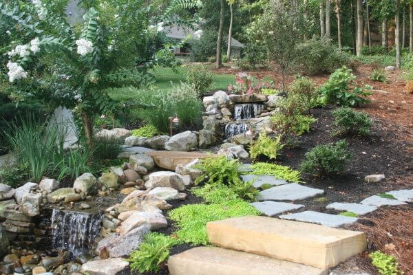 Pondless waterfall natural stone steps for Natural rock landscaping